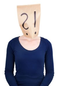 a person with a paper bag head on which are an question and an interrogation mark, isolated