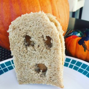 A peanut butter 'ghost' sandwich on whole grain bread