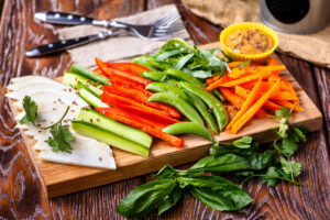 Pre-wash and slice vegetables for time saving meal prep strategies for healthy meal planning