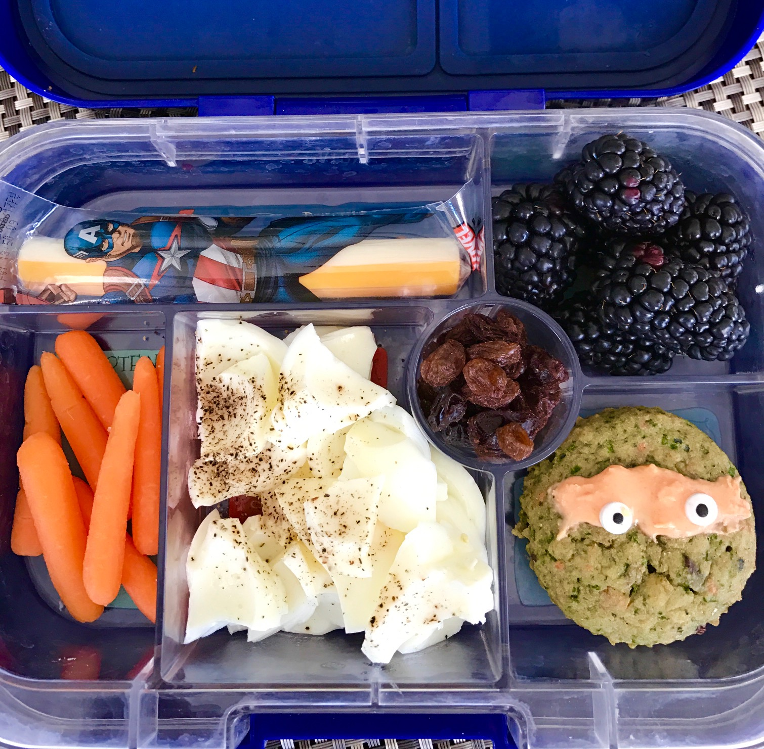 A healthy toddler lunch box meal including a green vegetable muffin