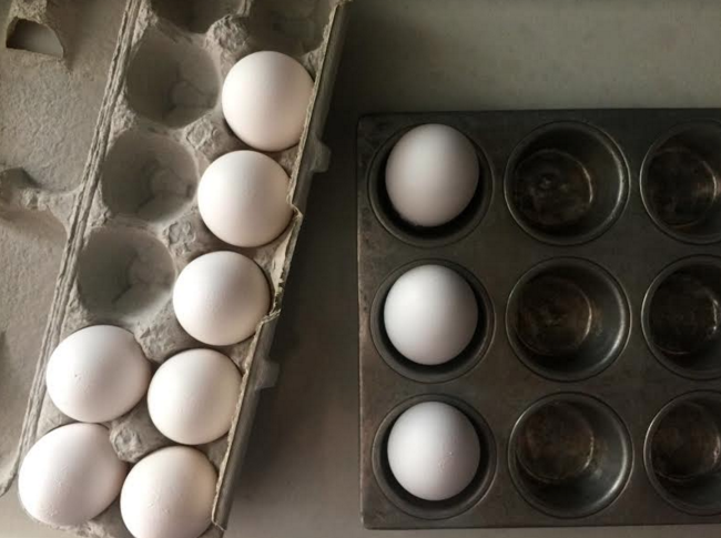 hard boil eggs in the oven in a muffin tin