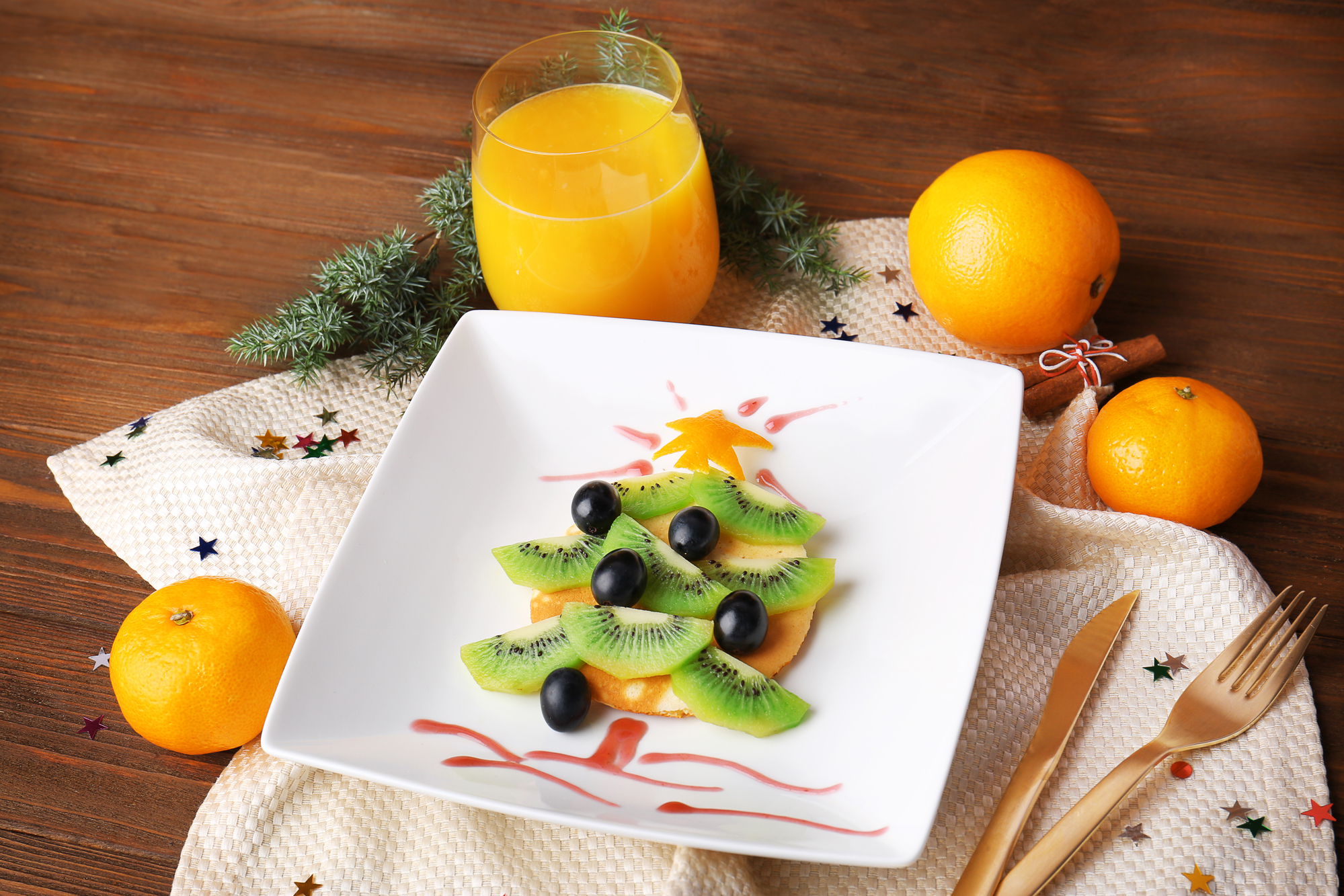 Christmas food idea for kids breakfast, on wooden background kiwi christmas tree food art