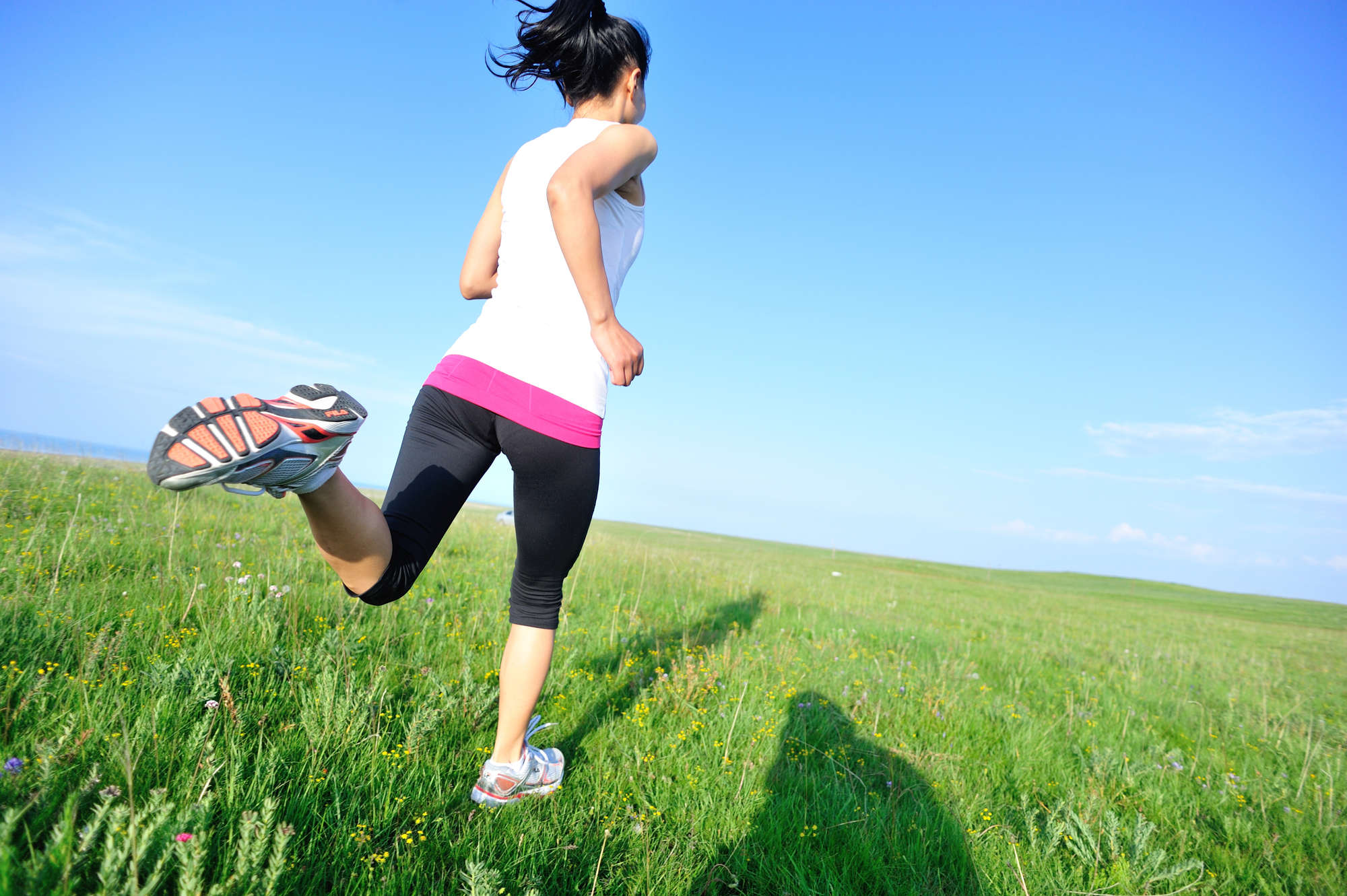 woman jogging how too much cardio can slow metabolism and how to boost metabolism fast