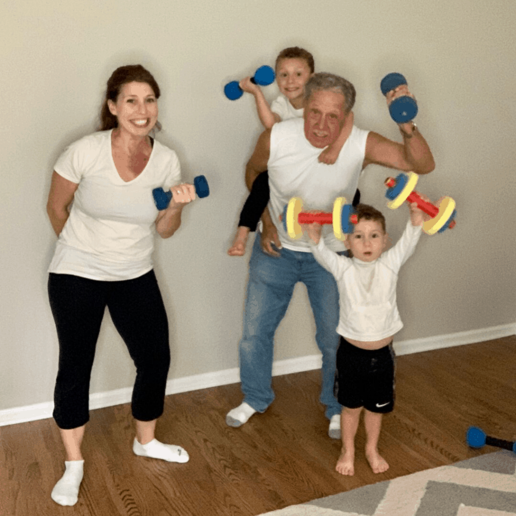 family exercising together with dumbbells