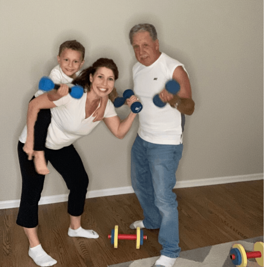 Mother exercising with son and grandfather