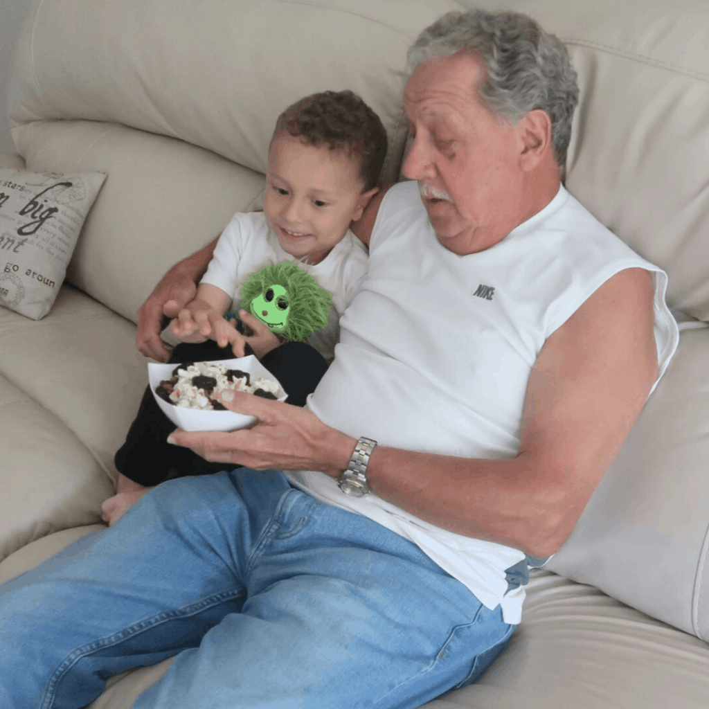 OD grandson and grandfather snacking together on trail mix with prunes