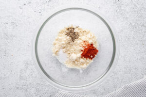 almond flour paprika salt and pepper in a small glass bowl