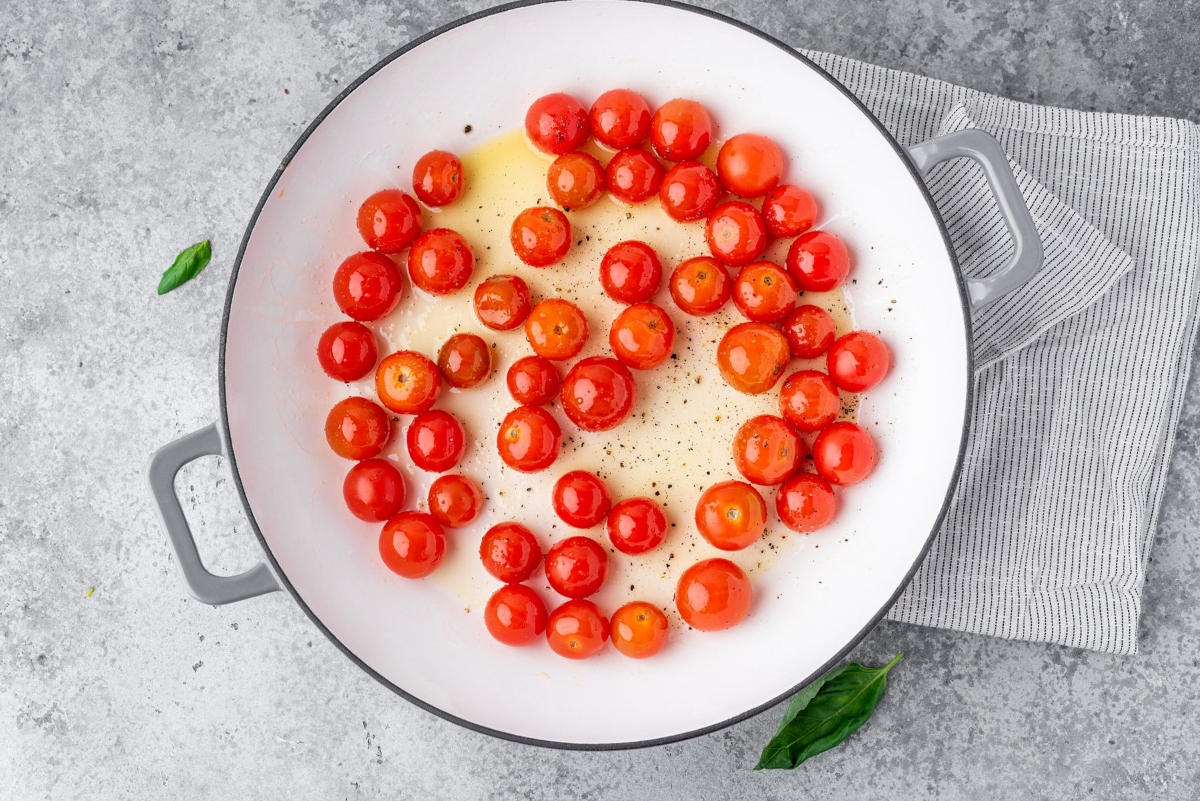 Cooking pan filled with cherry tomatoes and olive oil