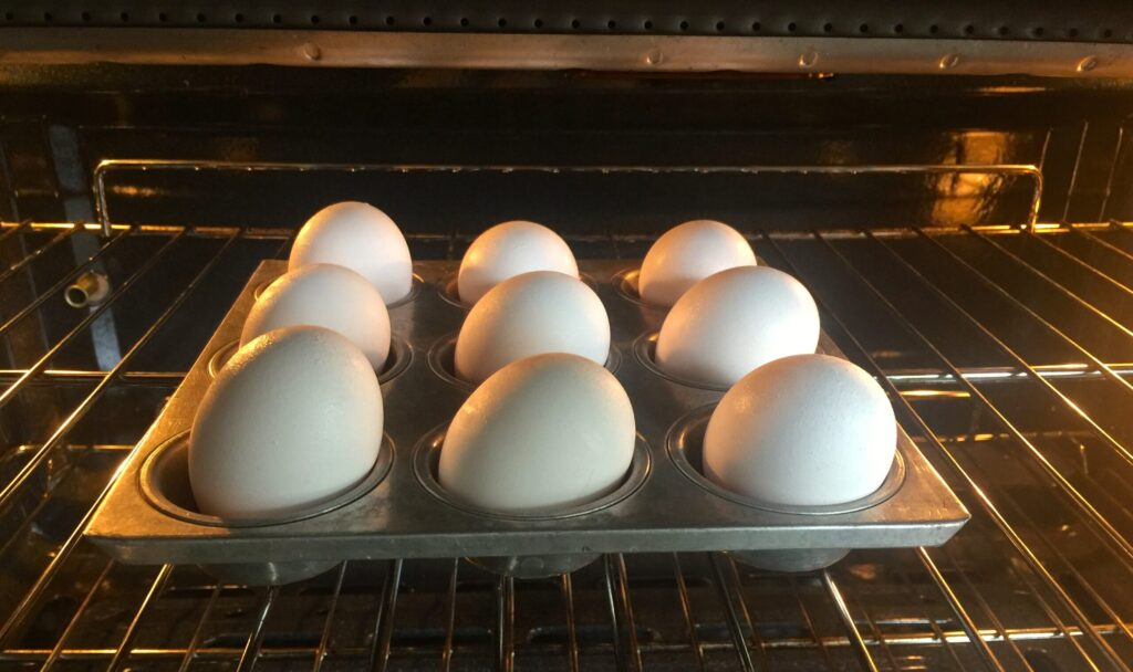 8 eggs in a muffin tin baking in the oven