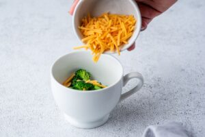 Adding Cheddar to the mug for easy microwave omelet