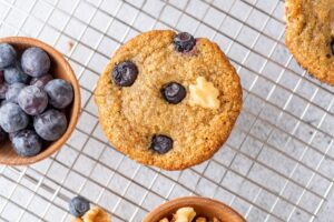 Oat Banana Blueberry Muffin with a bowl of blueberries