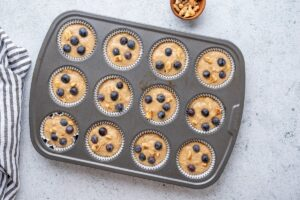Oat Banana Blueberry Muffins in Muffin Pan Ready to Bake