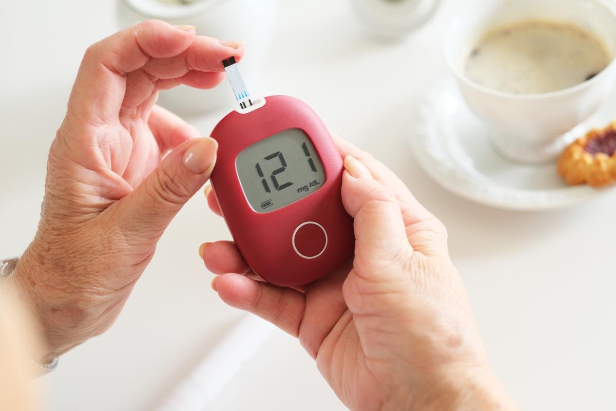 Testing blood with blood sugar meter