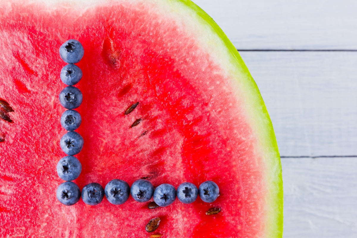 Watermelon and blueberries arranged like a clock