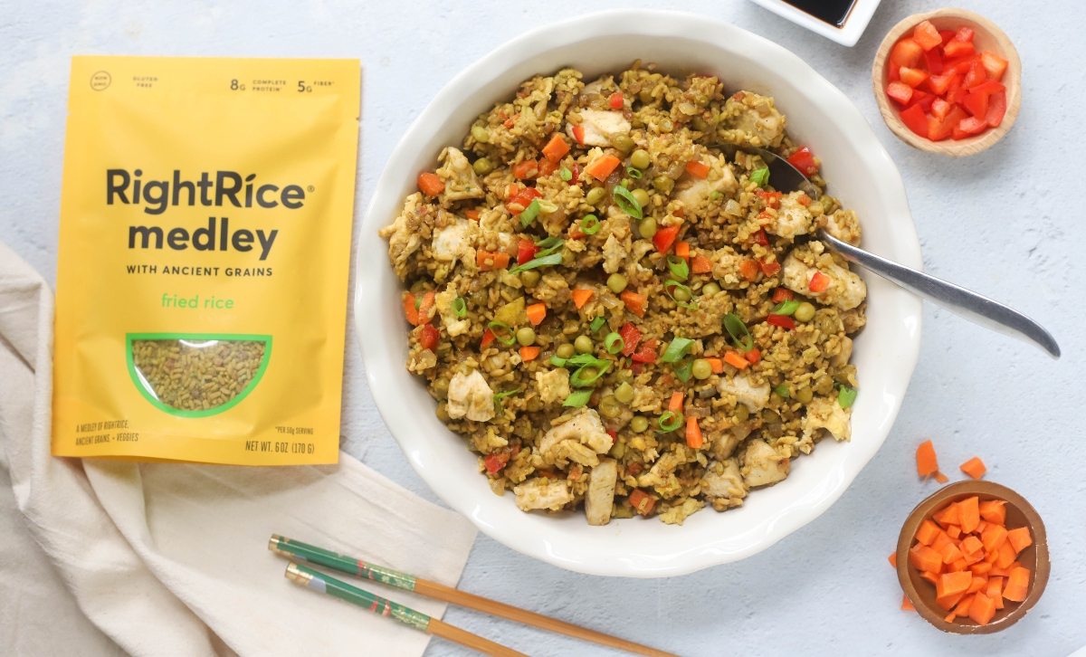 A large bowl of chicken fried rice with a rice package beside the bowl