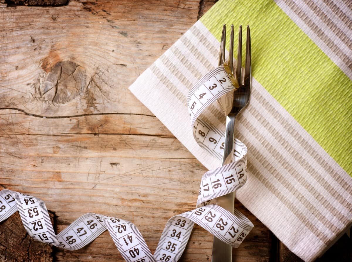 Fork and measuring tape on the cloth napkin