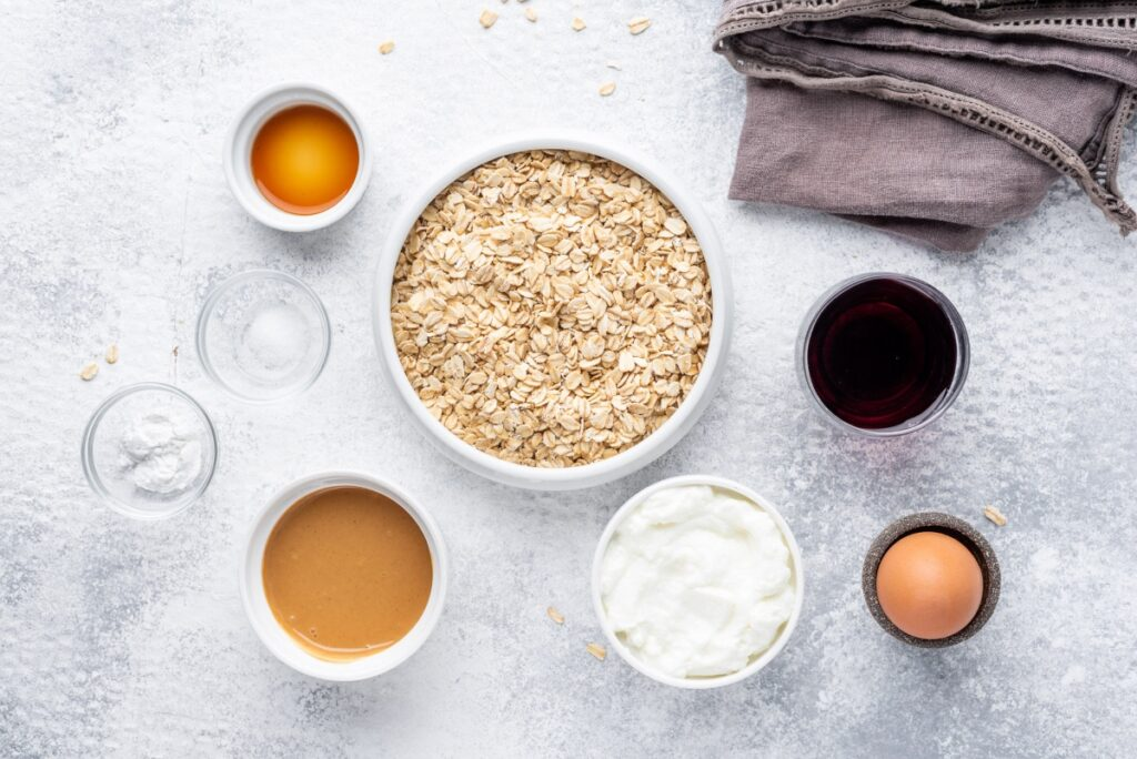 Food ingredients for peanut butter pancakes with jelly in bowls