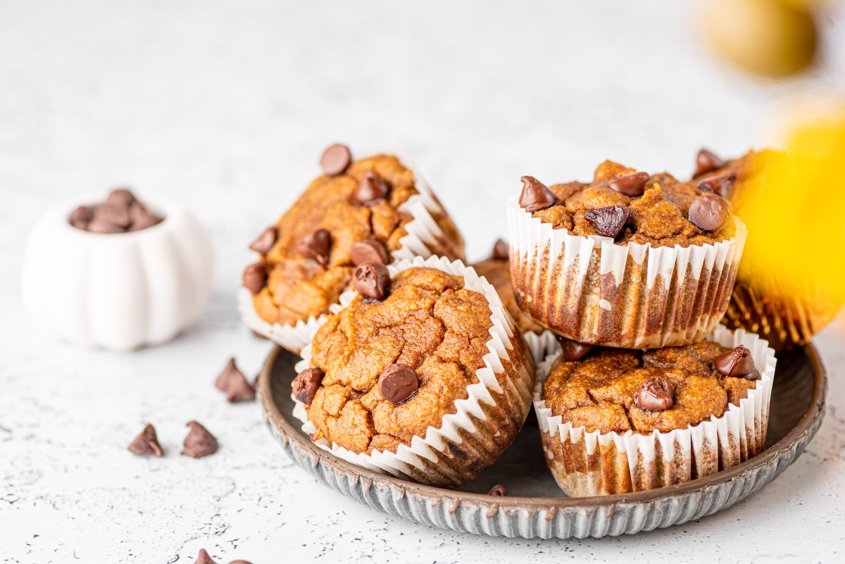 Stacked low carb pumpkin muffins on a round baking tray